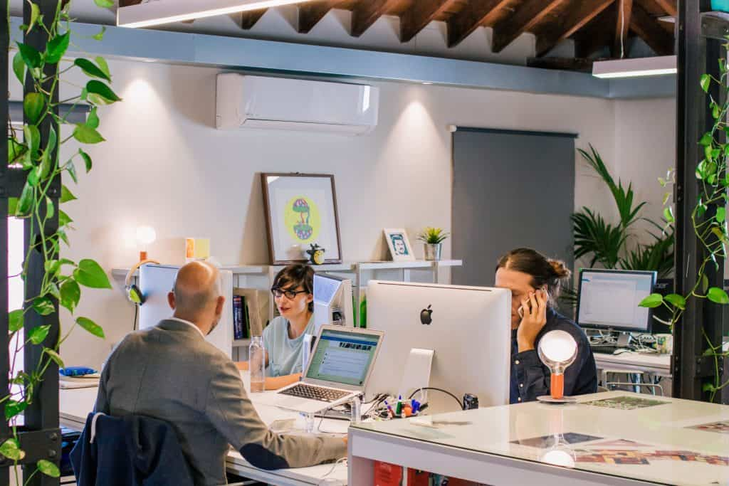 People focusing at work in an open office environment.